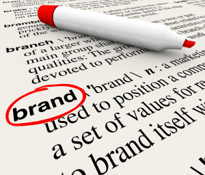 The word Brand defined in a dictionary with definition explained