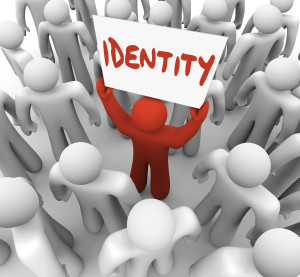 One person holds a sign or banner with the word Identity to spre
