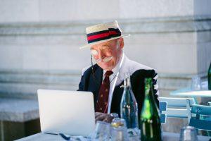 old man on laptop
